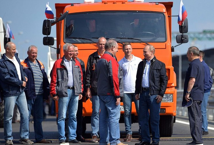 Putin drives truck across newly-opened Crimean bridge